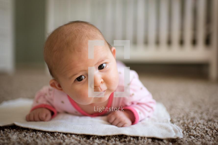 newborn on a nursery floor