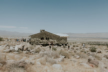 tourists gathered at a cabin in the desert