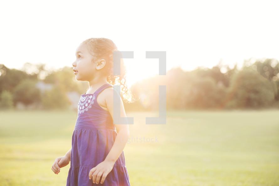 toddler girl outdoors enjoying summer time