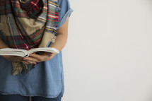 a torso of a woman reading a Bible, fall Bible study