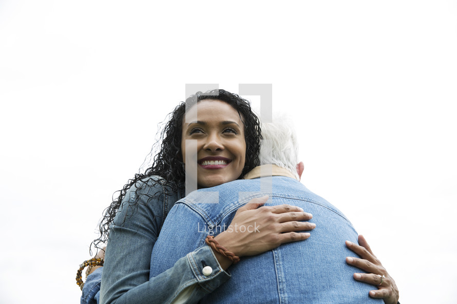 young woman hugging mature woman.