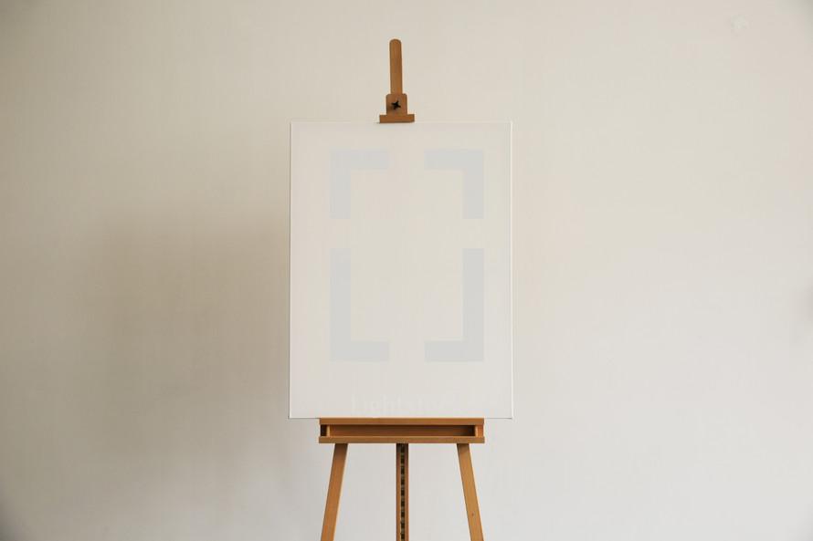 A blank canvas on an easel.