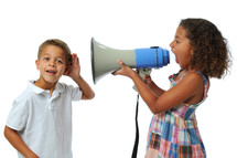 sister yelling at her brother with a megaphone