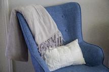 throw blanket over an arm chair