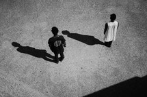 African American men standing creating shadows