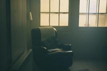 a recliner in a corner