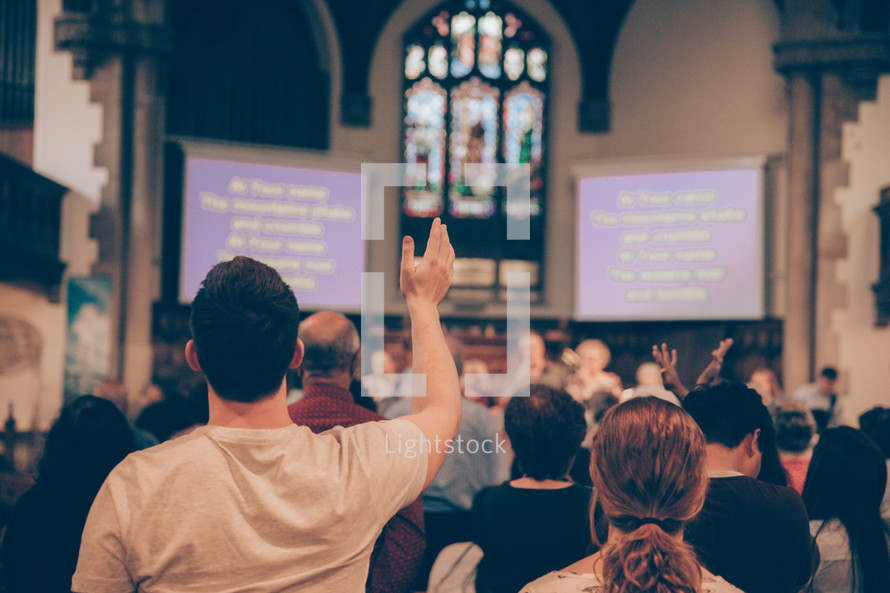 Man with hand raised in worship