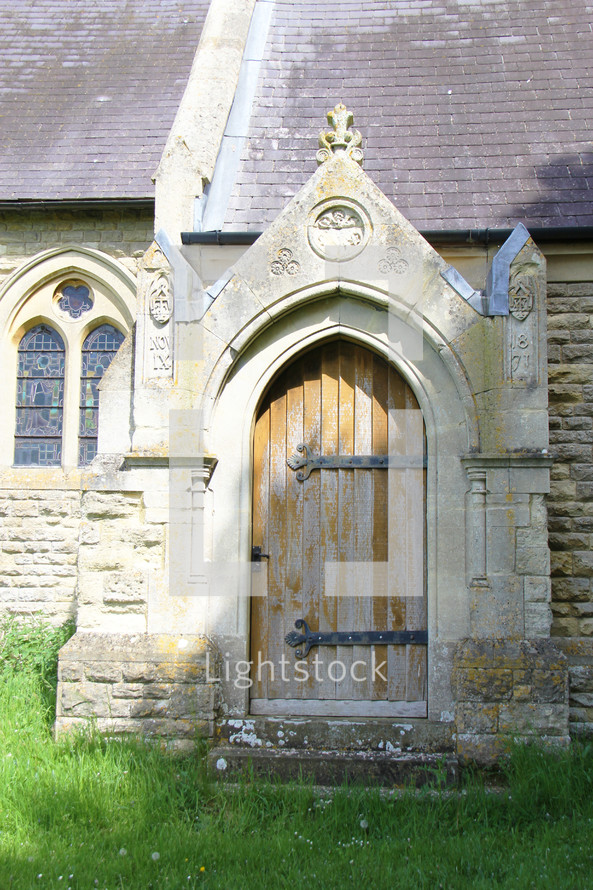 arched wooden door on a church