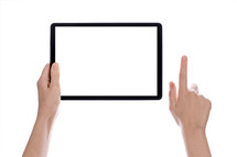 Hands holding a tablet computer with white screen.