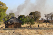 rising smoke from a village