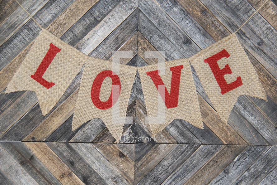 love banner on burlap against a wooden background
