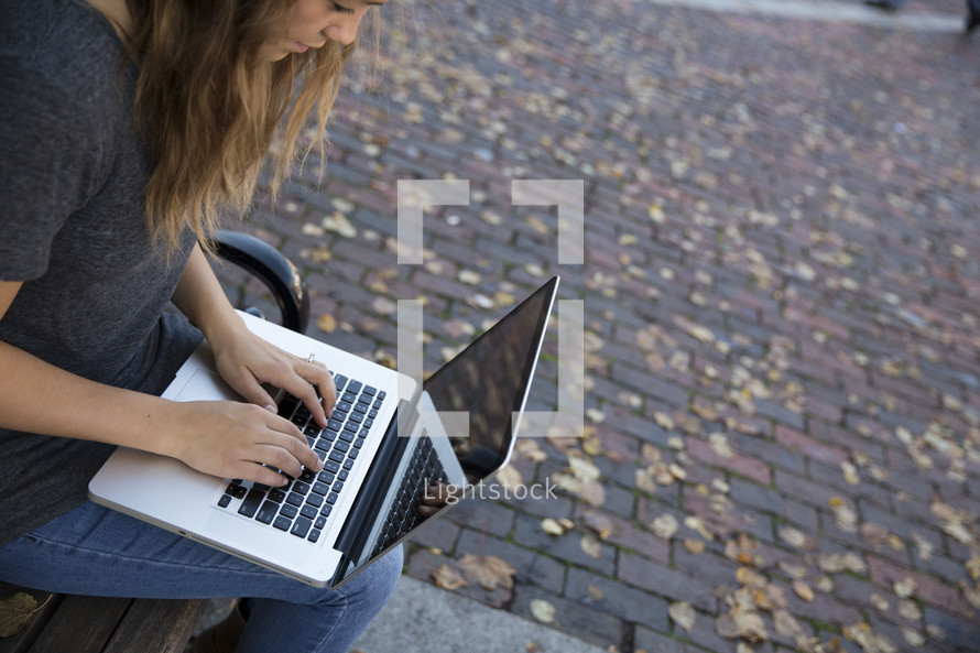 woman sitting with a laptop on her lap