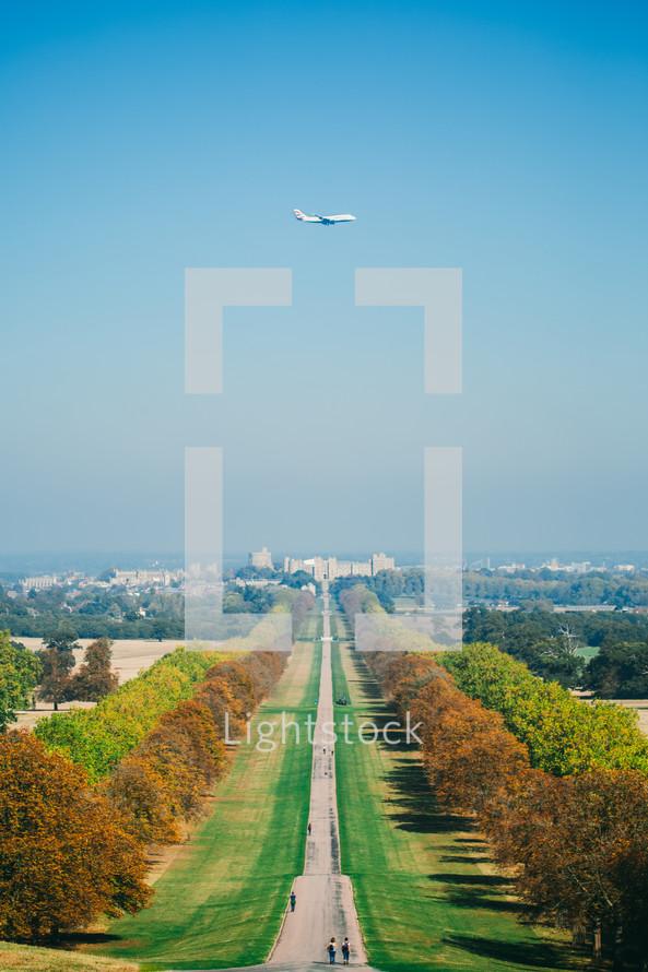 plane flying over an autumn  park
