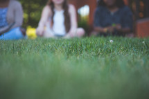 teen girl sitting in grass