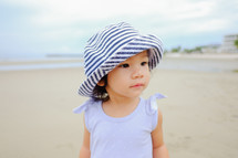 toddler girl on a beach