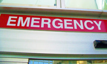 A large red Emergency room sign at an area hospital emergency room entrance.