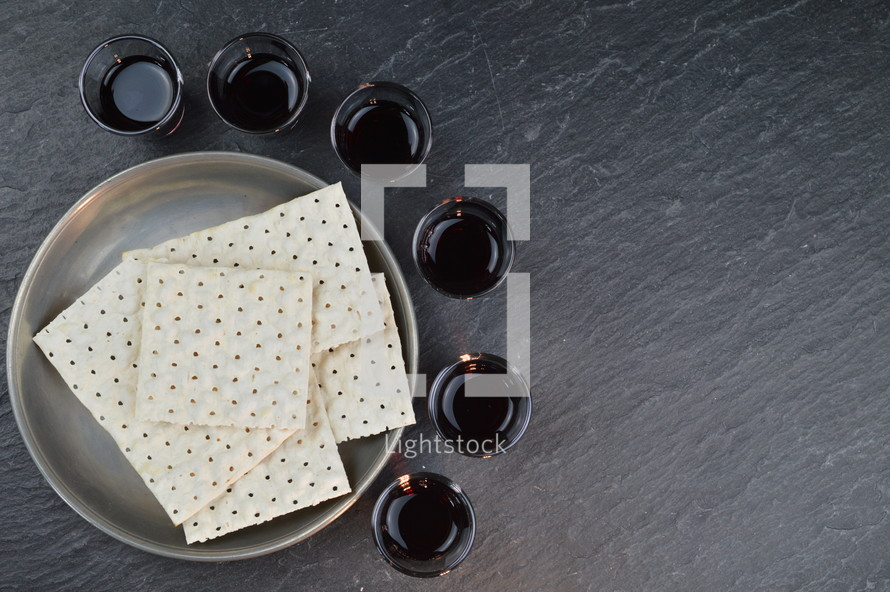 communion wine cups and unleavened bread