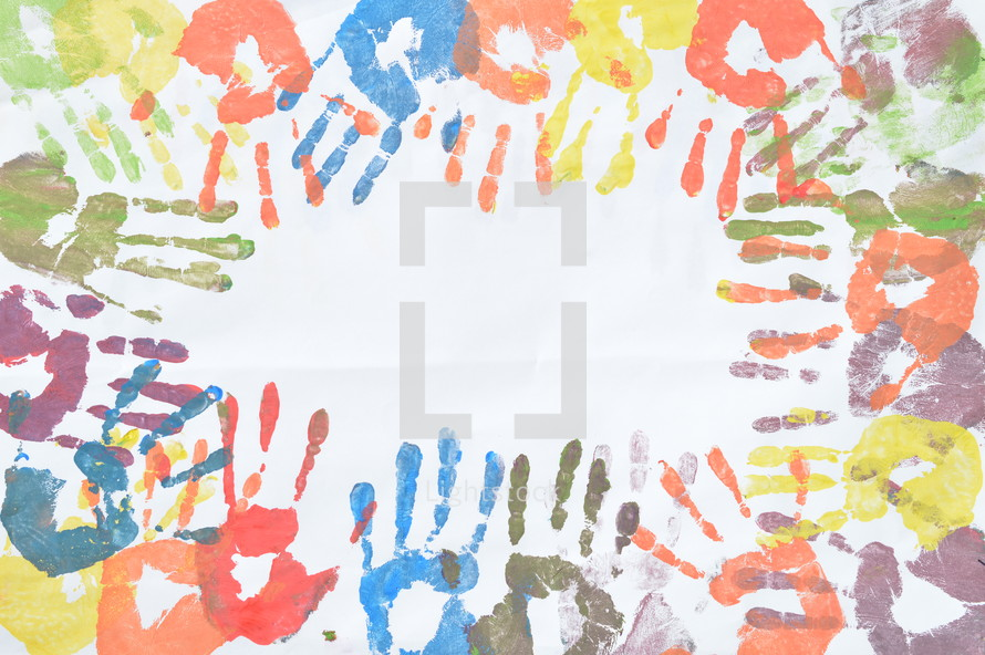frame of colorful handprints