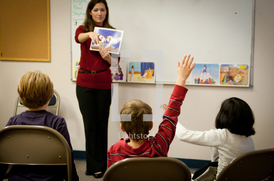 Teacher in a classroom presenting a lesson to students.