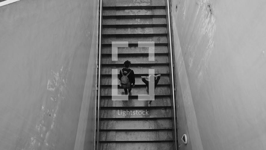 men walking up steps