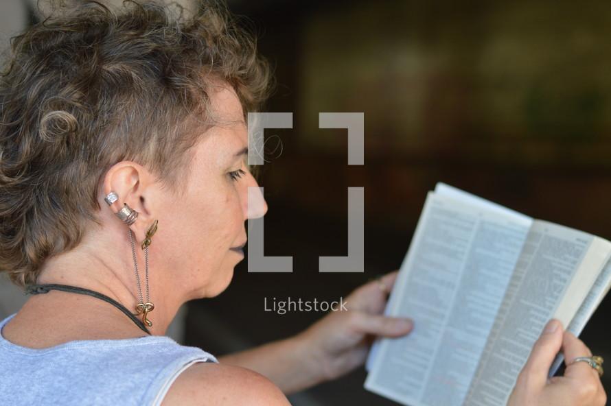 a woman battling addiction reading a Bible