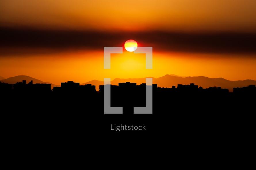 sun over a city