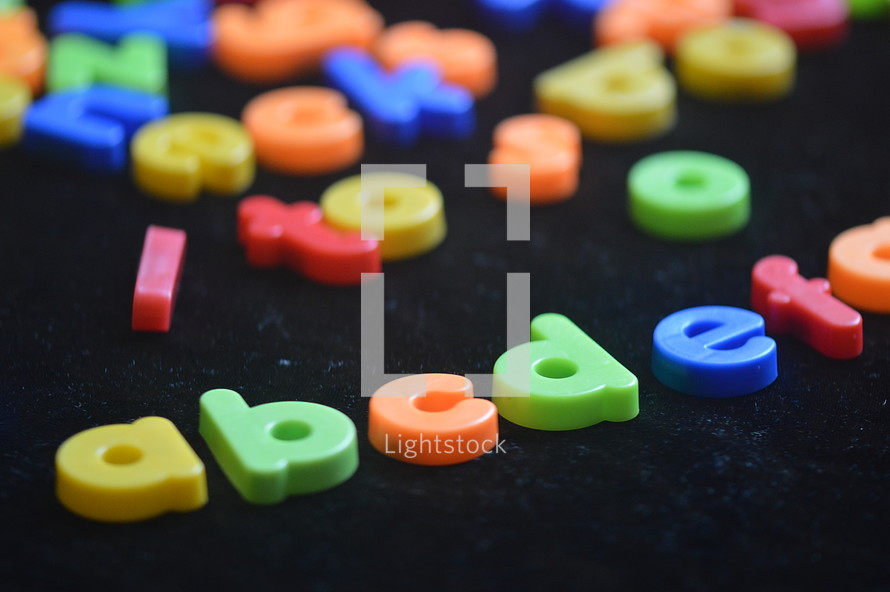 Colorful, magnetic alphabet letters.