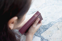 a woman holding a Bible