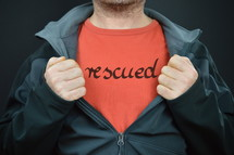 a man with the word rescued on his red t-shirt