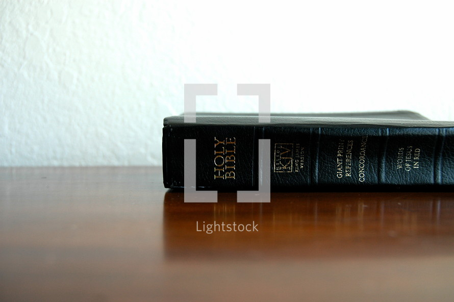 Bible on a wooden table.