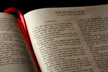 Open Bible in the book of Revelation