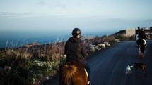 horseback riding on a trail