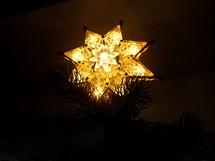 star ornament on a Christmas tree