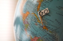 GO sign on a globe