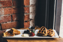 waffles on a plate and syrup