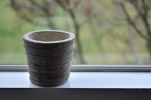 empty clay pot in a window sill