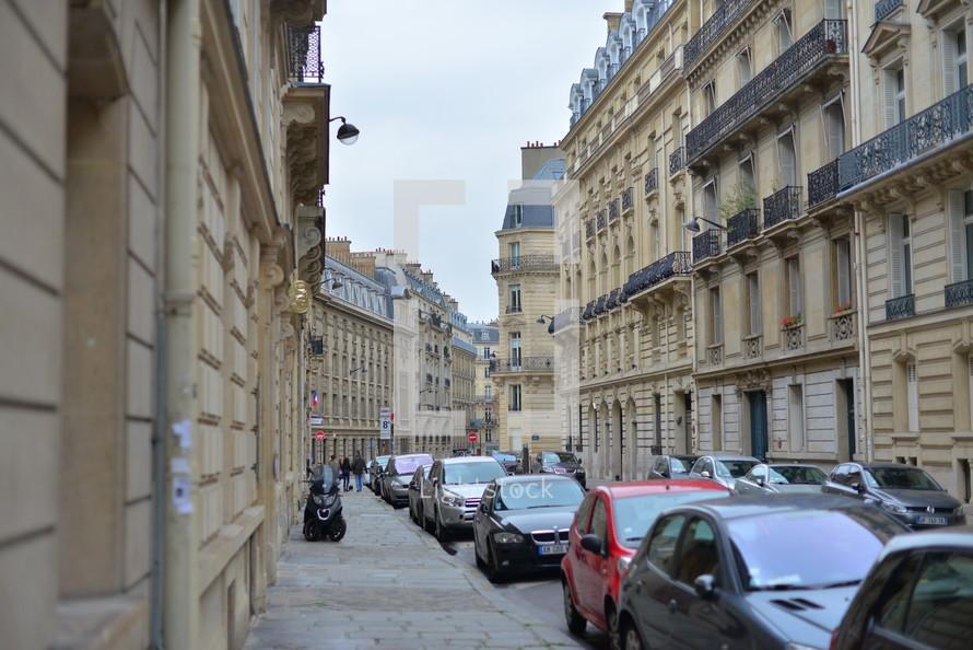 cars, parked, downtown, street, Europe, sky, row houses, buildings, sidewalk, scooter, crosswalk, terraces, balconies, European