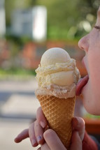 summertime - yummy ice-cream-time! child licking yummy ice cream in a cone