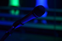 Microphone on dark stage.