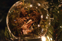 clear glass ball ornament on a Christmas tree