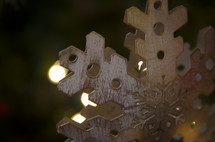 snowflake Christmas ornament on a Christmas tree