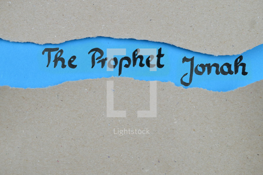 The Prophet Jonah - torn open kraft paper over blue paper with the name of the prophetic book Jonah