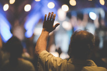 hands raised at a contemporary worship service