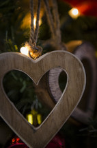 wooden heart Christmas ornaments on a Christmas tree