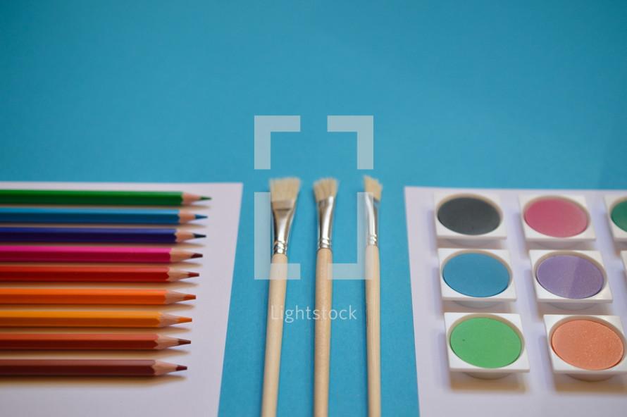 art supplies on cyan background