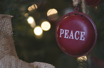 peace Christmas ornament on a Christmas tree