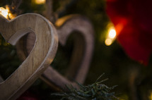 wooden hearts Christmas ornaments on a Christmas tree