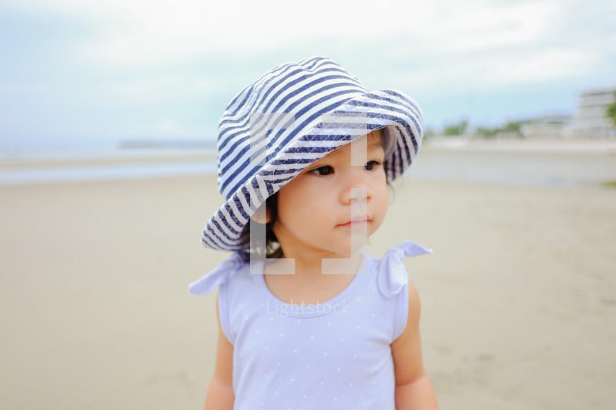 toddler girl on a beach