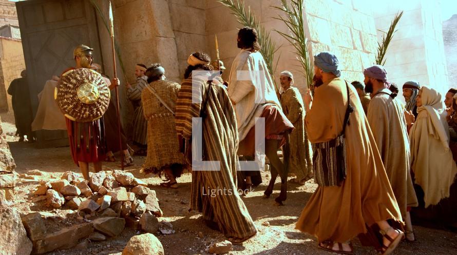 Jesus comes to Jerusalem as King riding on a donkey