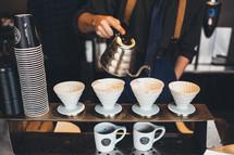 barista filtering coffee